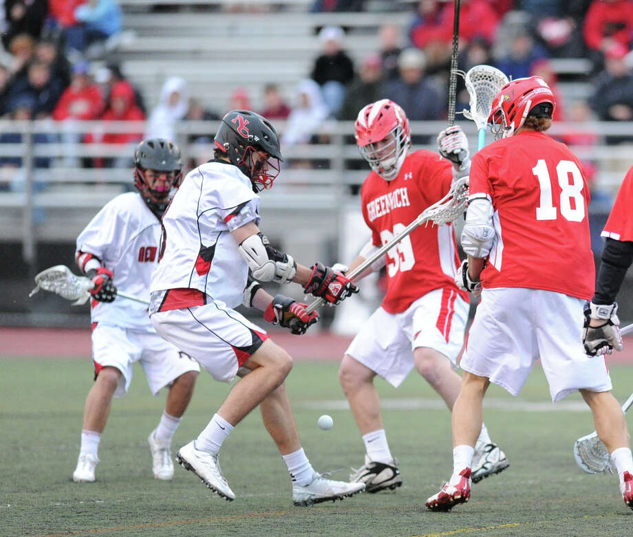 At right, Kelley Jay (# 18) of Greenwich and others scramble for a loose ball during the FCIAC boys high school lacrosse championship match between Greenwich High School and New Canaan High School at Brien McMahon High School in Norwalk, Friday night, May 24, 2013. New Canaan took the title defeating Greenwich, 8-5. Photo: Bob Luckey / Greenwich Time