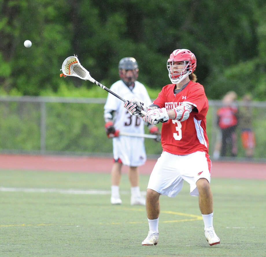 At right, Kyle Foote (# 3) of Greenwich passes during the FCIAC boys high school lacrosse championship match between Greenwich High School and New Canaan High School at Brien McMahon High School in Norwalk, Friday night, May 24, 2013. New Canaan took the title defeating Greenwich, 8-5. Photo: Bob Luckey / Greenwich Time