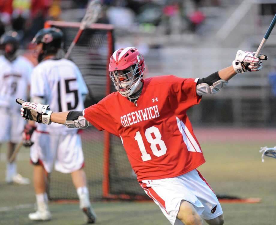 Kelley Jay (# 18) of Greenwich after scoring a goal during the FCIAC boys high school lacrosse championship match between Greenwich High School and New Canaan High School at Brien McMahon High School in Norwalk, Friday night, May 24, 2013. New Canaan took the title defeating Greenwich, 8-5. Photo: Bob Luckey / Greenwich Time