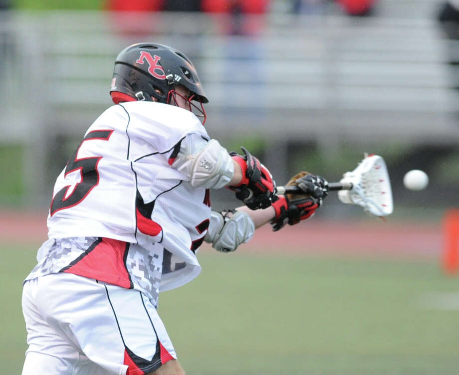Duke Repko (# 25) of New Canaan shoots during the FCIAC boys high school lacrosse championship match between Greenwich High School and New Canaan High School at Brien McMahon High School in Norwalk, Friday night, May 24, 2013. New Canaan took the title defeating Greenwich, 8-5. Photo: Bob Luckey / Greenwich Time