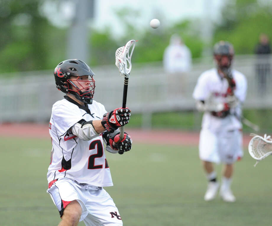 Duke Repko (# 25) of New Canaan during the FCIAC boys high school lacrosse championship match between Greenwich High School and New Canaan High School at Brien McMahon High School in Norwalk, Friday night, May 24, 2013. New Canaan took the title defeating Greenwich, 8-5. Photo: Bob Luckey / Greenwich Time