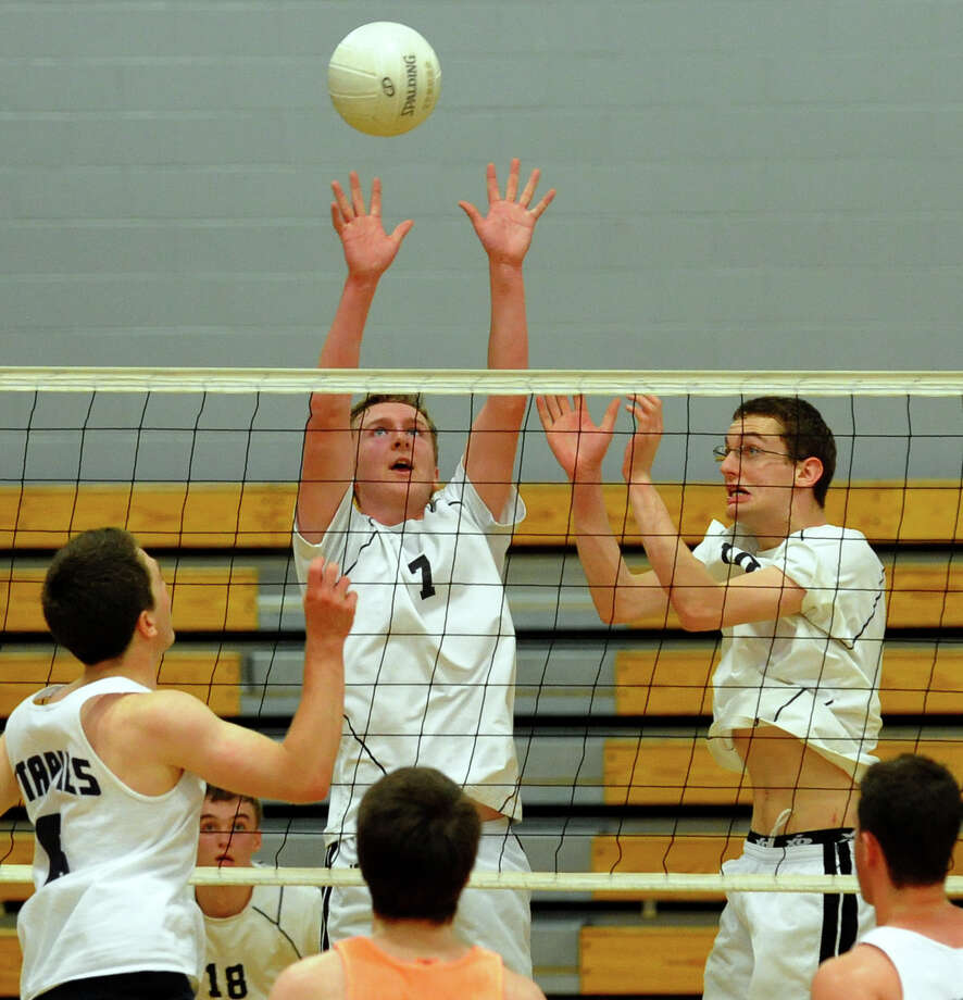 Ridgefield's Paul Cooke reaches to keep the ball in play, during FCIAC Boys' Volleyball Championship game action against Staples at Fairfield Ludlowe High in Fairfield, Conn. on Friday May 24, 2013. Photo: Christian Abraham / Connecticut Post