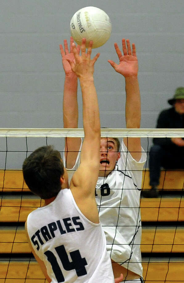 Ridgefield's Tyler Chittenden tries to block Staples' Lucas Carstens, during FCIAC Boys' Volleyball Championship game action at Fairfield Ludlowe High in Fairfield, Conn. on Friday May 24, 2013. Photo: Christian Abraham / Connecticut Post