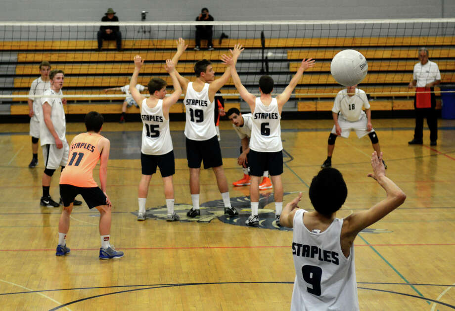 FCIAC Boys' Volleyball Championship game action between Ridgefield and Staples at Fairfield Ludlowe High in Fairfield, Conn. on Friday May 24, 2013. Photo: Christian Abraham / Connecticut Post