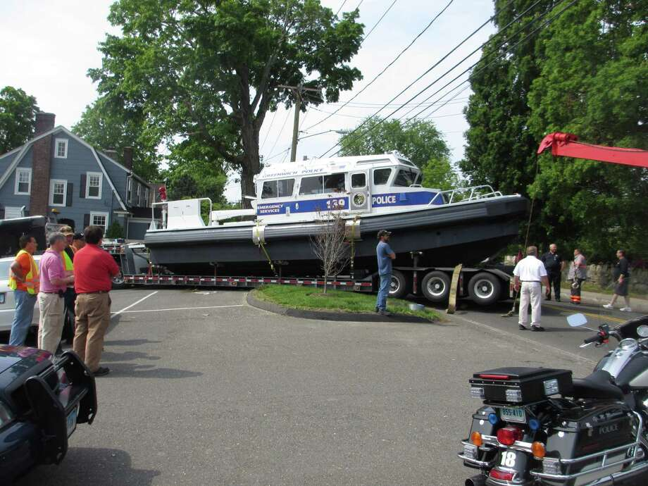 The town's new emergency services boat got hung up on an island Thursday - a traffic island. Photo: Contributed Photo