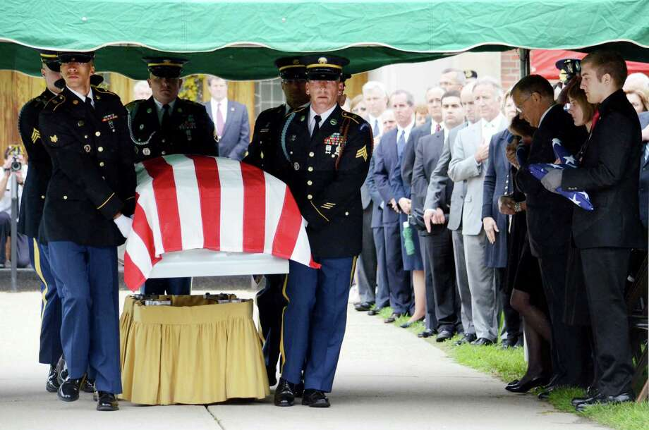 An honor guard carries the casket of U.S. Army Spc. Mitchell Daehling after his funeral at St Agnes Roman Catholic Church in Dalton, Mass., Friday, May 24, 2013. The soldier was killed by an improvised explosive device May 14 in Afghanistan. He will receive the Bronze Star and Purple Heart posthumously. (AP Photo/Berkshire Eagle, Ben Garver) Photo: Ben Garver