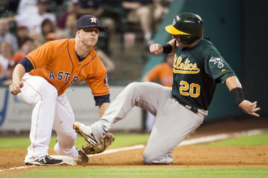 Astros third baseman tags out Josh Donaldson of the A's.