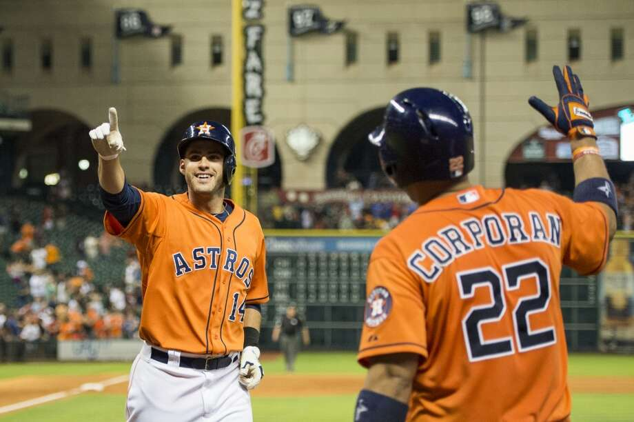 J.D. Martinez of the Astros is congratulated by Carlos Corporan after hitting a home run.