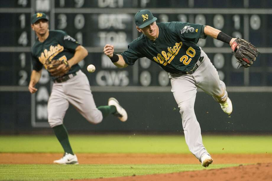 A's third baseman Josh Donaldson can't make the play on a soft grounder by Astros left fielder Robbie Grossman during the fifth inning.