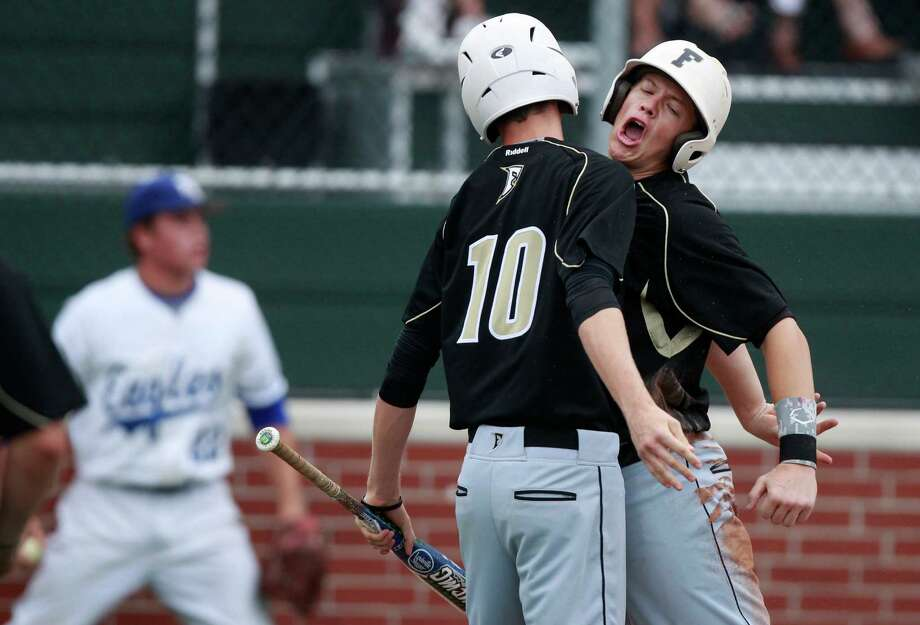 Foster's Brock Keener, right, celebrates with teammate Conner Parker after scoring on Lucas DuVal's double in the first inning of Friday night's Class 4A Region III semifinal game against Barbers Hill at Memorial. Photo: J. Patric Schneider, Freelance / © 2013 Houston Chronicle