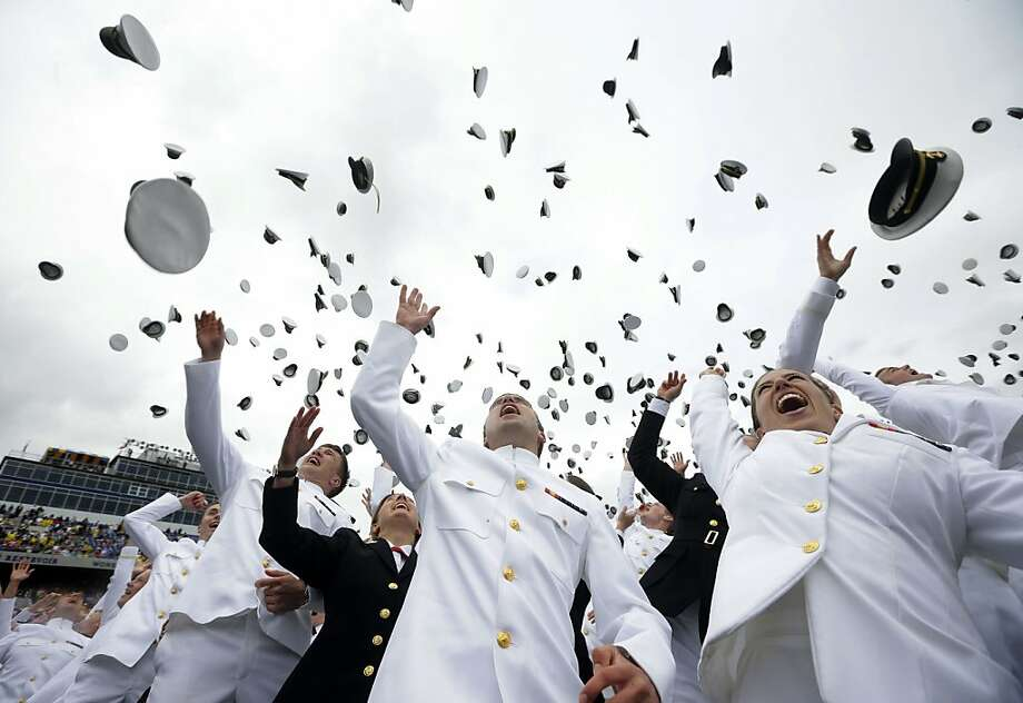 Members of the 2013 graduating class of the United States Naval Academy throw their caps into the air marking the end of their commencement ceremony in Annapolis, Md,. Friday, May 24, 2013, where President Barack Obama spoke. (AP Photo/Pablo Martinez Monsivais) Photo: Pablo Martinez Monsivais, Associated Press