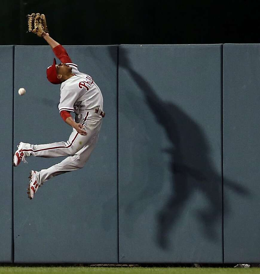 Philadelphia Phillies center fielder Ben Revere (2) cannot catch a one-RBI triple hit by Washington Nationals' Adam LaRoche during the fifth inning of a baseball game at Nationals Park, Friday, May 24, 2013, in Washington. (AP Photo/Alex Brandon) Photo: Alex Brandon, Associated Press