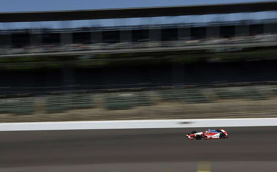 Justin Wilson, of England, heads into the first turn during the final practice session for the Indianapolis 500 auto race at the Indianapolis Motor Speedway in Indianapolis, Friday, May 24, 2013. (AP Photo/Darron Cummings) Photo: Darron Cummings, Associated Press