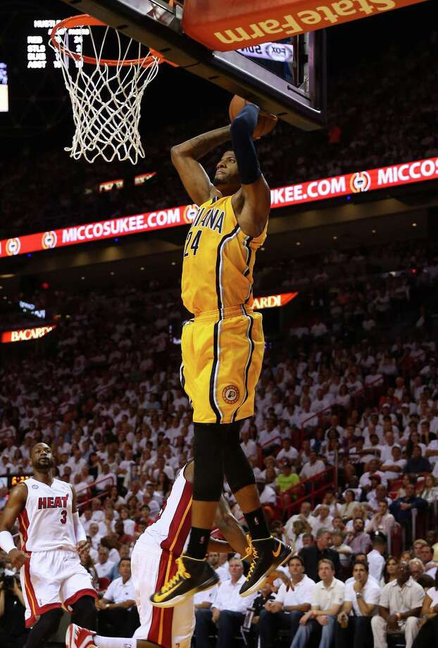 MIAMI, FL - MAY 24: Paul George #24 of the Indiana Pacers goes up for a dunk in the third quarter against the Miami Heat during Game Two of the Eastern Conference Finals at AmericanAirlines Arena on May 24, 2013 in Miami, Florida. NOTE TO USER: User expressly acknowledges and agrees that, by downloading and or using this photograph, user is consenting to the terms and conditions of the Getty Images License Agreement.  (Photo by Mike Ehrmann/Getty Images) Photo: Mike Ehrmann