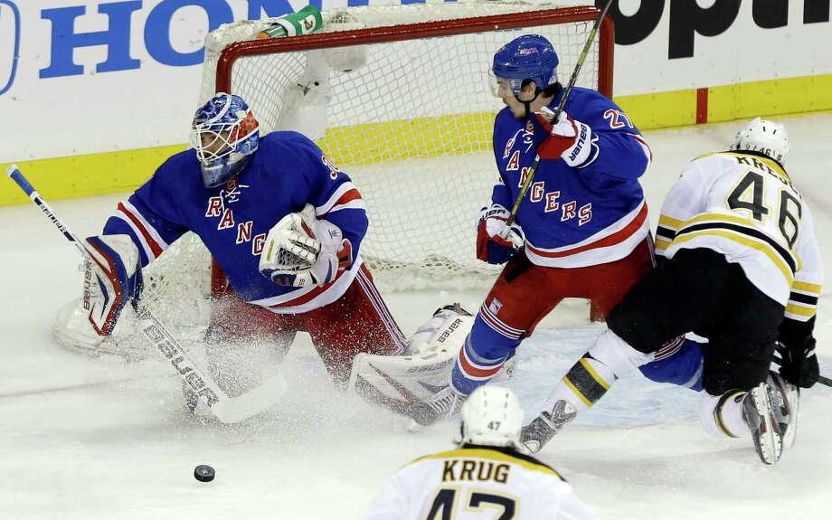New York Rangers goalie Henrik Lundqvist (30),of Sweden, deflects a shot on-goal by Boston Bruins' David Krejci (46) as teammate Ryan McDonagh (27) looks on during the first period in Game 4 of the Eastern Conference semifinals in the NHL hockey Stanley Cup playoffs on Thursday, May 23, 2013, in New York. (AP Photo/Frank Franklin II) Photo: Frank Franklin II