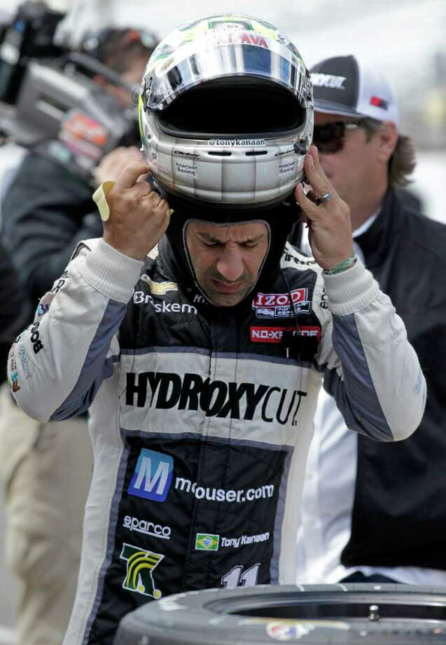 IndyCar driver Tony Kanaan, of Brazil, puts on his helmet as he prepares to drive in the final practice session for the Indianapolis 500 auto race at the Indianapolis Motor Speedway in Indianapolis, Friday, May 24, 2013. (AP Photo/AJ Mast) Photo: AJ Mast