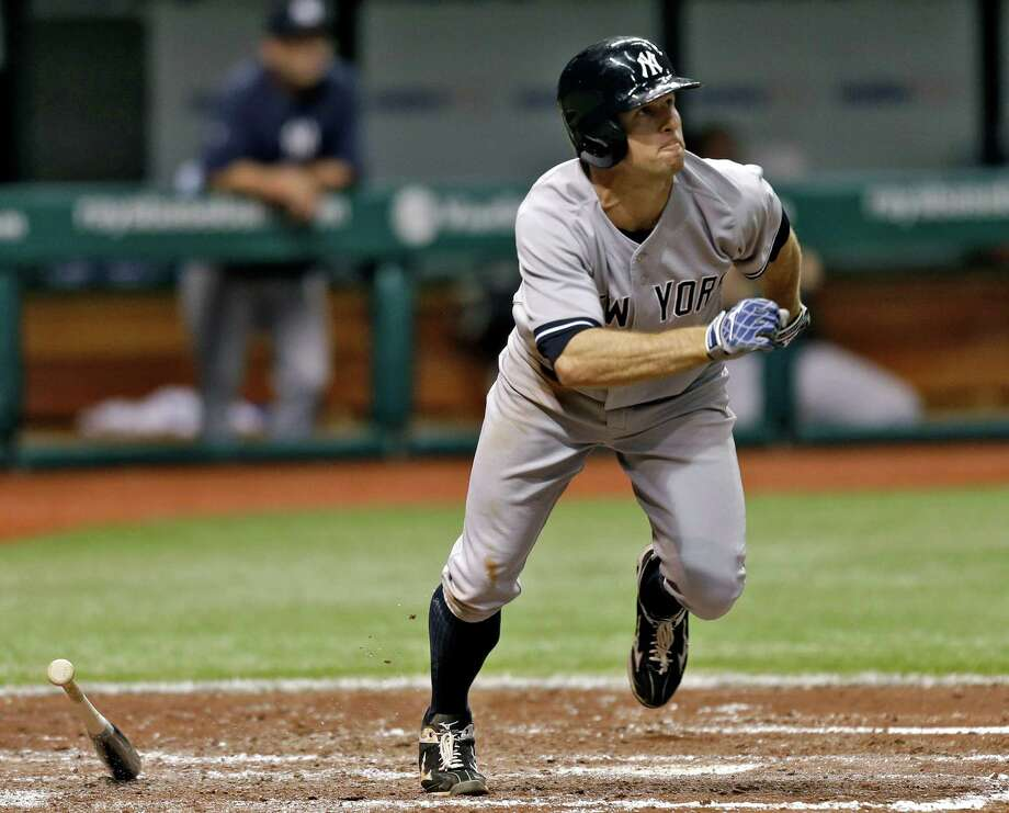 New York Yankees' Brett Gardner follows the flight of his fourth-inning, two- run home run off Tampa Bay Rays starting pitcher Roberto Hernandez during a baseball game, Friday, May 24, 2013, in St. Petersburg, Fla. (AP Photo/Chris O'Meara) Photo: Chris O'Meara