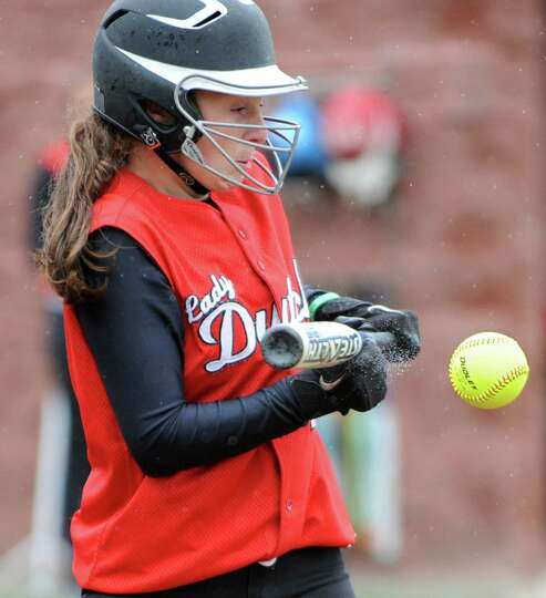 Guilderland's Doris Kane bunts the ball and brings in two runs due to an overthrow to third base dur