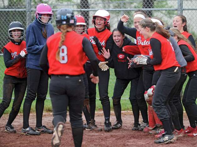 Guilderland's Mallory Harrigan gets a warm reception at home plate after hitting the ball over the left field fence for a home run during the Class AA quarterfinal softball game against Columbia on Friday, May 24, 2013 in Guilderland, N.Y.  (Lori Van Buren / Times Union) Photo: Lori Van Buren / 00022552A