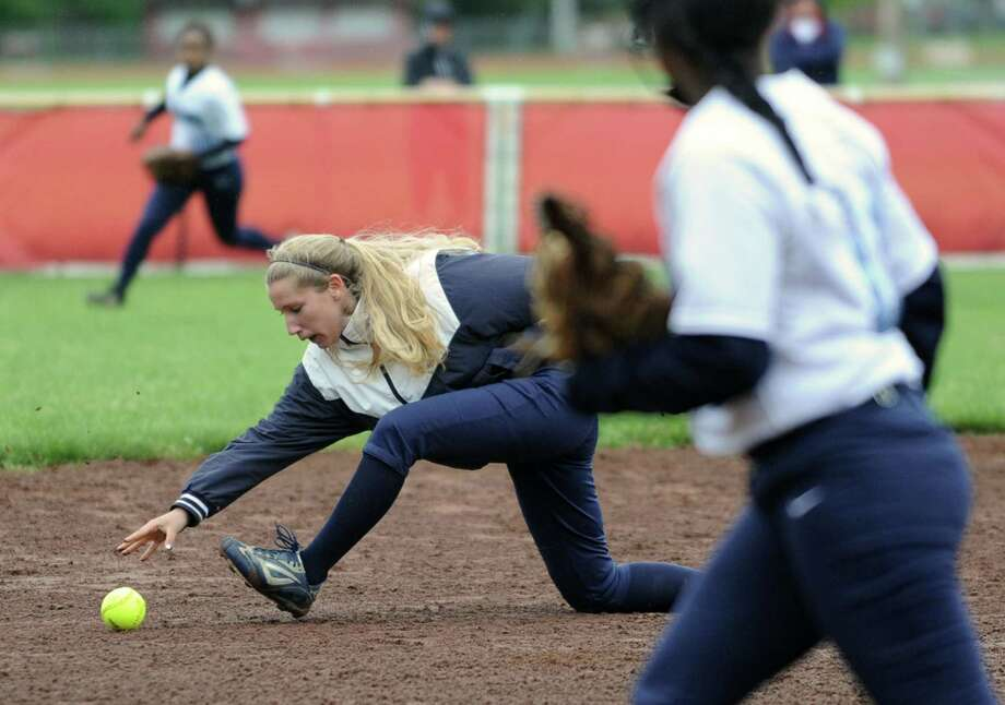 Columbia shortstop Jess Adams knocks down a line drive and tries to throw the runner out at first during the Class AA quarterfinal softball game against Guilderland on Friday, May 24, 2013 in Guilderland, N.Y.  (Lori Van Buren / Times Union) Photo: Lori Van Buren / 00022552A