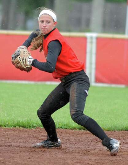 Guilderland shortstop Jenna Cubello throws the ball to first making the out during the Class AA quar