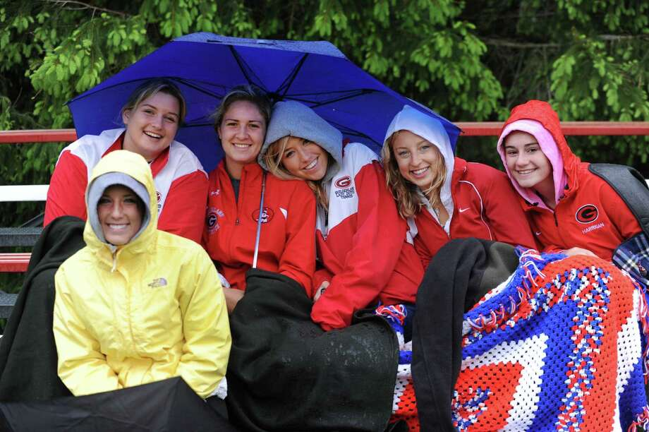 Guilderland girls from various teams brave the rainy weather to support their school during the Class AA quarterfinal softball game against Columbia on Friday, May 24, 2013 in Guilderland, N.Y.  (Lori Van Buren / Times Union) Photo: Lori Van Buren / 00022552A