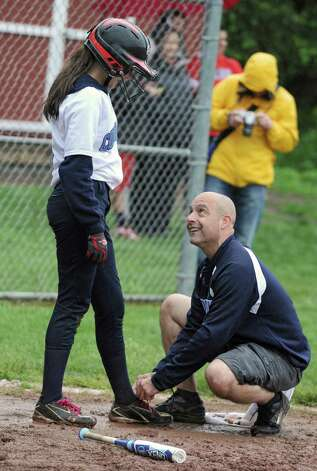 Columbia head coach Chris Ciccone ties the shoe for  batter Samantha Hart during the Class AA quarterfinal softball game against Guilderland on Friday, May 24, 2013 in Guilderland, N.Y. Sammy called the coach over to help as she couldn't tie her own laces with the batting gloves on. (Lori Van Buren / Times Union) Photo: Lori Van Buren / 00022552A