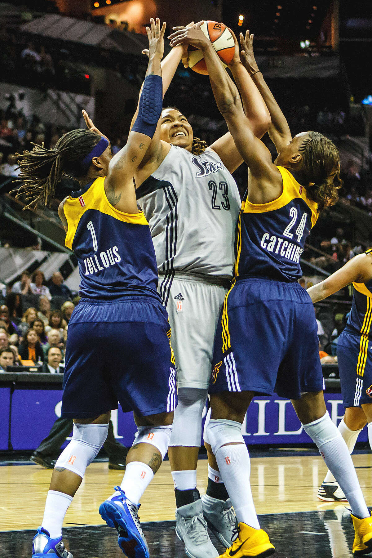 Shavonte Zellous (left) and Tamika Catchings, who each scored 19 points for Indiana, defend the Silver Stars' Danielle Adams.