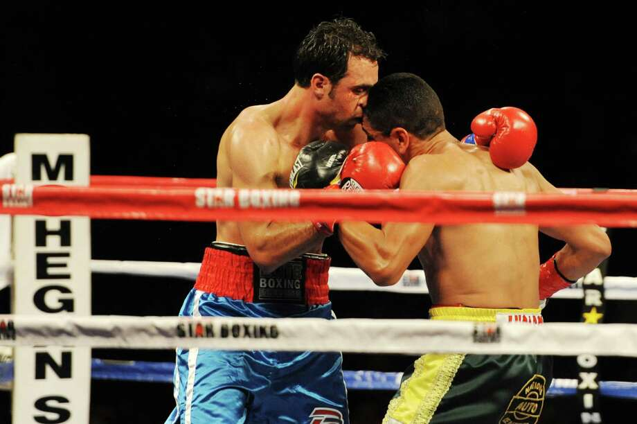"""Danbury boxer Delvin Rodriguez, left, fights Freddy Hernandez for the IBF North American junior-middleweight title in the main event of ESPN's """"Friday Night Fights"""" at the Mohegan Sun Casino in Uncasville, Conn. on Friday, May 24, 2013. Photo: Tyler Sizemore / The News-Times"""