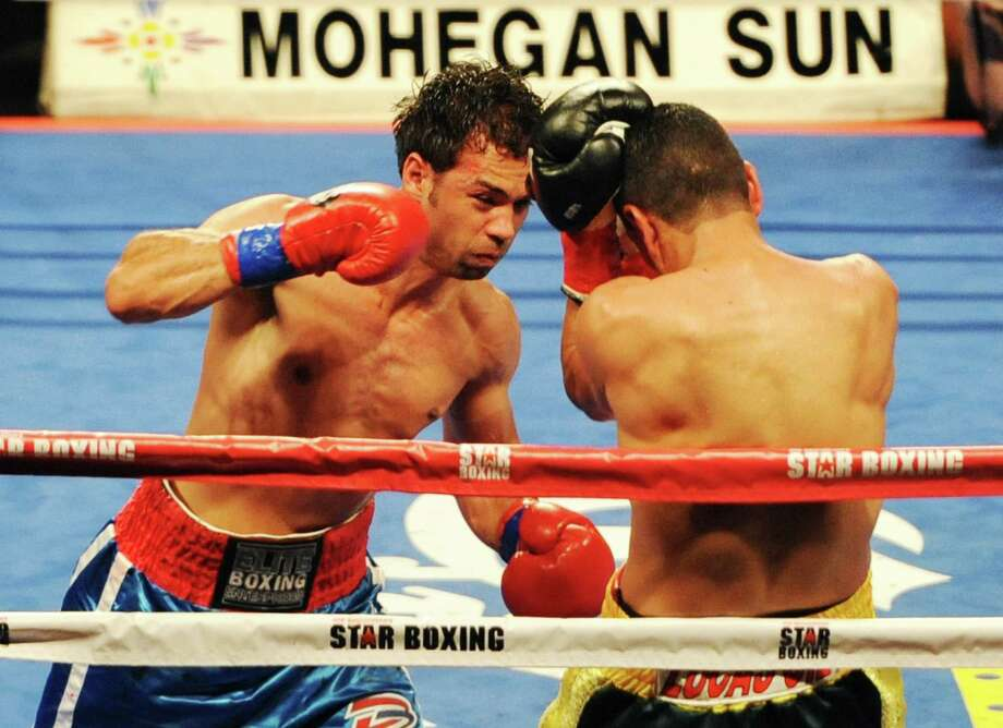 "Danbury boxer Delvin Rodriguez, left, fights Freddy Hernandez for the IBF North American junior-middleweight title in the main event of ESPN's ""Friday Night Fights"" at the Mohegan Sun Casino in Uncasville, Conn. on Friday, May 24, 2013. Photo: Tyler Sizemore / The News-Times"
