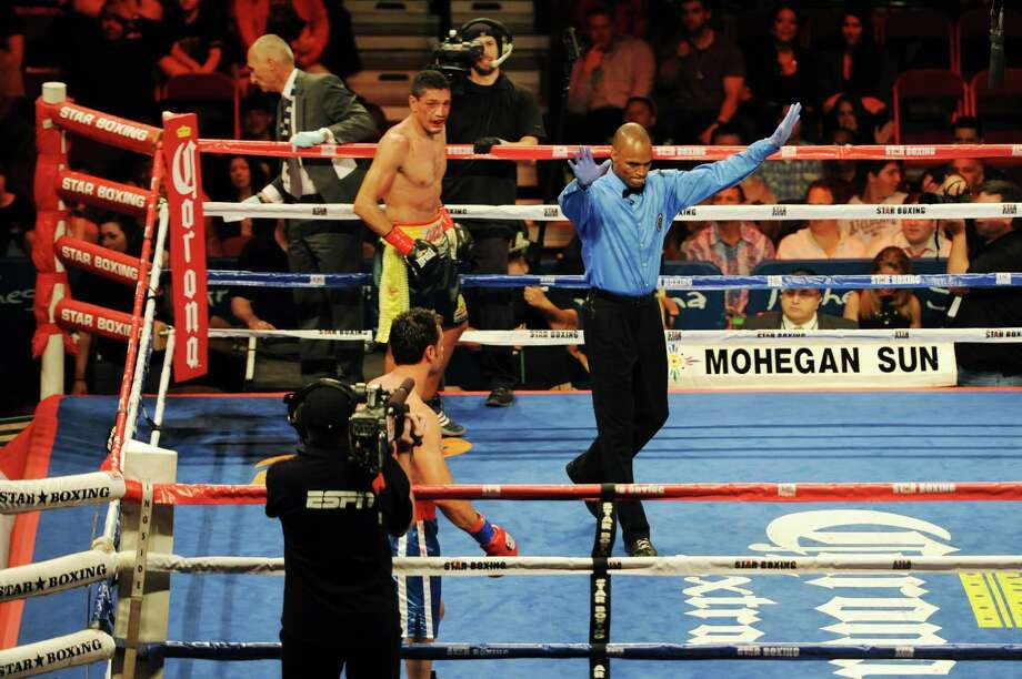 "The referee calls a stop to the fight between Danbury boxer Delvin Rodriguez, below, and Freddy Hernandez for the IBF North American junior-middleweight title in the main event of ESPN's ""Friday Night Fights"" at the Mohegan Sun Casino in Uncasville, Conn. on Friday, May 24, 2013. Photo: Tyler Sizemore / The News-Times"