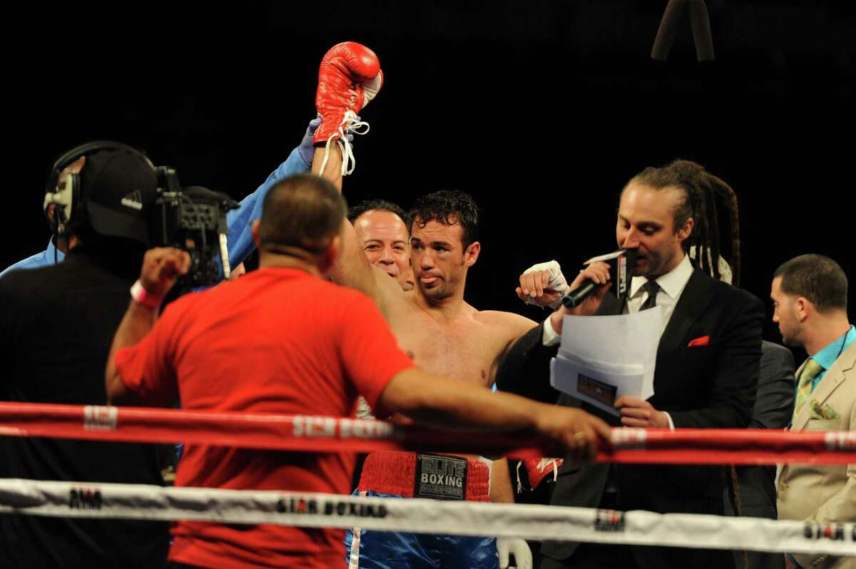 Danbury boxer Delvin Rodriguez celebrates his win after fighting Freddy Hernandez for the IBF North American junior-middleweight title in the main event of ESPN's