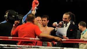 """Danbury boxer Delvin Rodriguez celebrates his win after fighting Freddy Hernandez for the IBF North American junior-middleweight title in the main event of ESPN's """"Friday Night Fights"""" at the Mohegan Sun Casino in Uncasville, Conn. on Friday, May 24, 2013."""