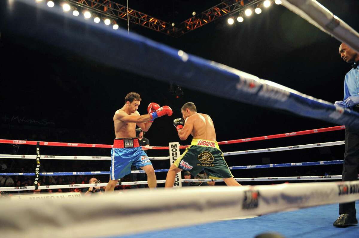 Danbury boxer Delvin Rodriguez, left, fights Freddy Hernandez for the IBF North American junior-middleweight title in the main event of ESPN's