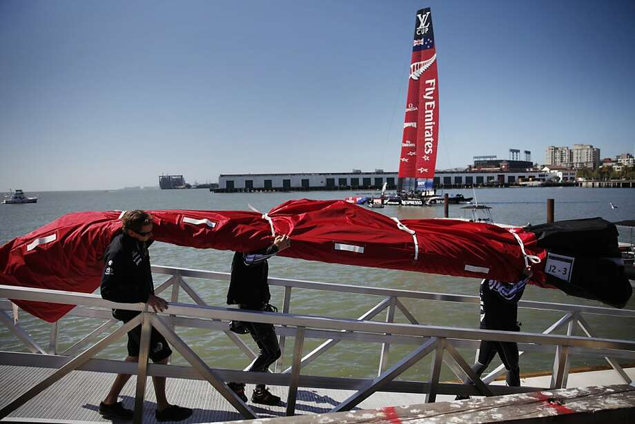 Members of Emirates Team New Zealand carry supplies down to the dock at Pier 30/32 before the new AC 72 is taken out to sail on San Francisco Bay on  Friday, May 24, 2013 in San Francisco, Calif.  The AC72 debuted the day before but today was their first proper day of sailing on San Francisco Bay. Photo: Lea Suzuki, The Chronicle