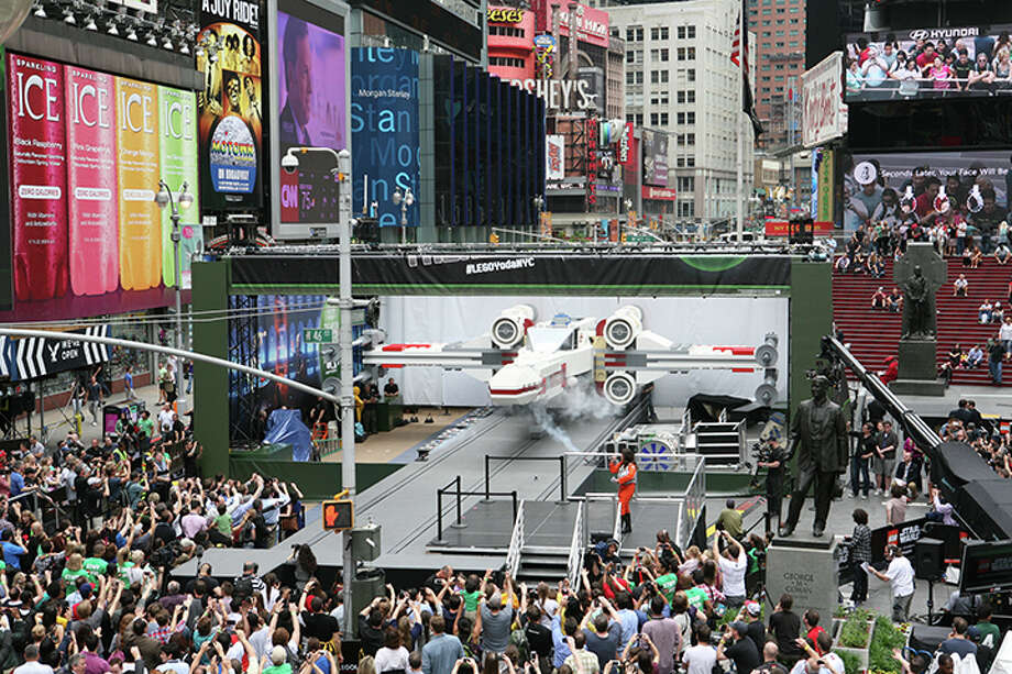 IMAGE DISTRIBUTED FOR LEGO SYSTEMS, INC. - Thousands gather in New York City's Times Square to watch the unveiling of the world's largest LEGO Model, a 1:1 replica of the LEGO Star Wars X-wing Starfighter that took 32 Model Builders, 5.3 million LEGO bricks and over 17,000 hours to complete, Thursday May 23, 2013. (Amy Sussman/AP Images for The LEGO Group) Photo: Amy Sussman, AP Images For LEGO Systems, Inc. / AP Images