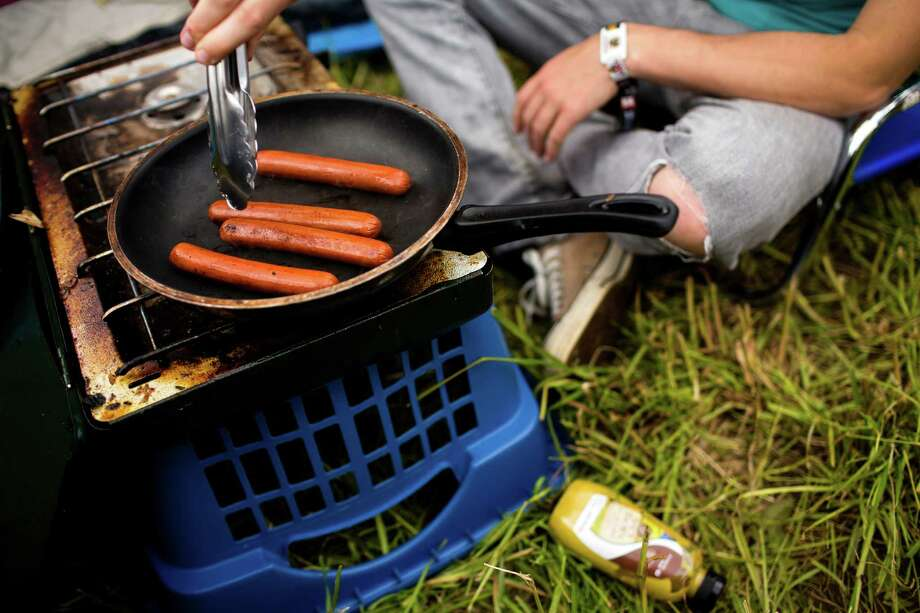 Campers cook a quick hotdog lunch before the first day of the annual Sasquatch music festival Friday, May 24, 2013, at The Gorge Amphitheatre in George. Photo: JORDAN STEAD, SEATTLEPI.COM / SEATTLEPI.COM