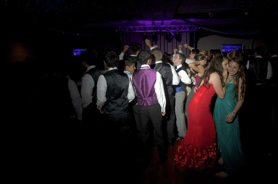 Prom-goers dancing at the Danbury High School senior prom which was held at the The Amber Room Colonnade, Danbury, Conn. Friday May 24, 2013. Photo: H John Voorhees III
