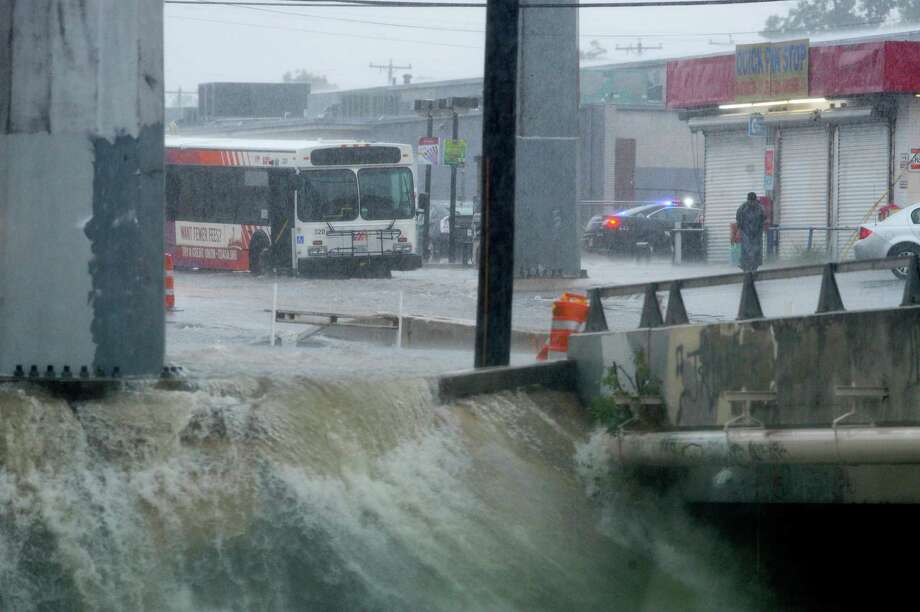 A bus is stranded in the water on Blanco Road near Basse during heavy rains in San Antonio on Saturday morning, May 25, 2013. Photo: Billy Calzada, San Antonio Express-News / San Antonio Express-News