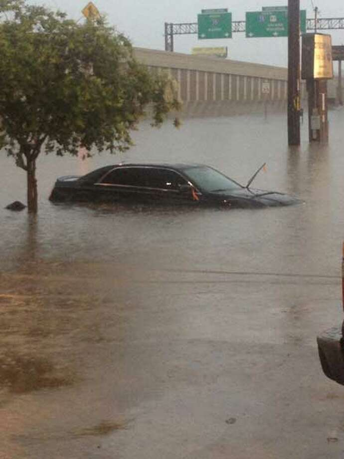 """Photo taken by stranded motorist Andy Staudt, who was stuck at an Exxon station Saturday morning at Hildebrand and Interstate 10. Staudt took pictures of some other cars in floodwaters on Hildebrand. He reported the drivers were """"OK."""""""