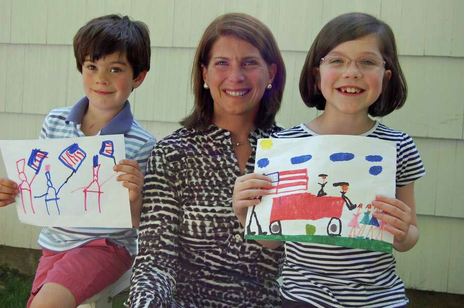 The winners of the inaugural Memorial Day parade children's drawing contest, Wyatt Robbins, left and Charlotte Ward, right, were not only invited to march on Monday, May 27, but they got their photograph taken with First Selectman Jayme Stevenson. Photo: Contributed