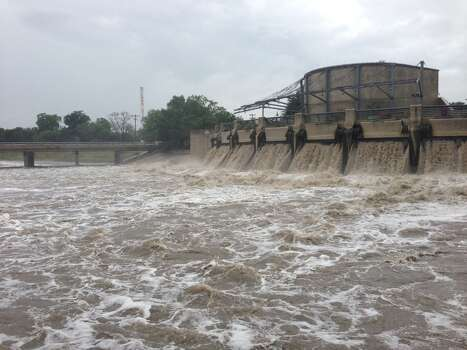Water pours out of the San Antonio River Flood Control Tunnel's outlet at Mission Reach, near Lone Star Blvd. Photo: Nolan Hicks / Express-News