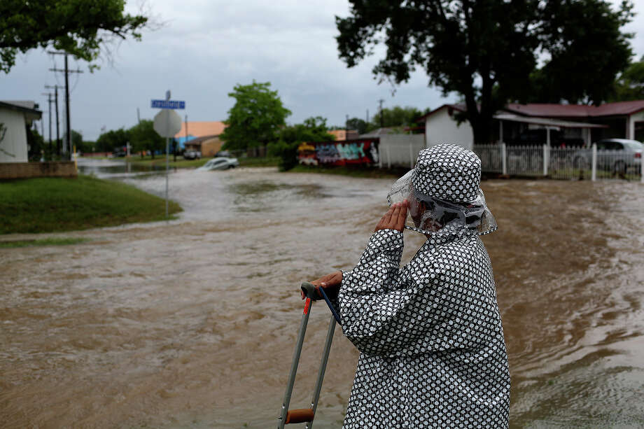 Katherine Clark watches flooding at Crestfield Street and Castleridge Dr. in the Westwood Village neighborhood off Military Dr. West on Saturday, May 25, 2013. Photo: Lisa Krantz, San Antonio Express-News / San Antonio Express-News