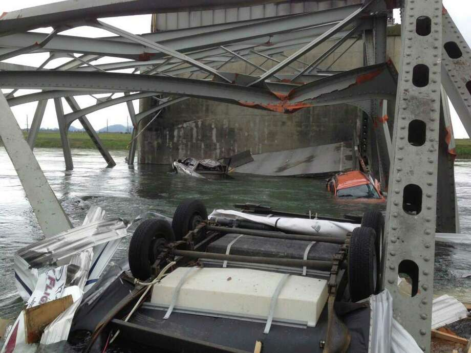 In this photo provided by the National Transportation Safety Board, the collapsed section of the Interstate 5 bridge is shown from a boat on the river. Photo: Photo Via NTSB, NTSB / NTSB