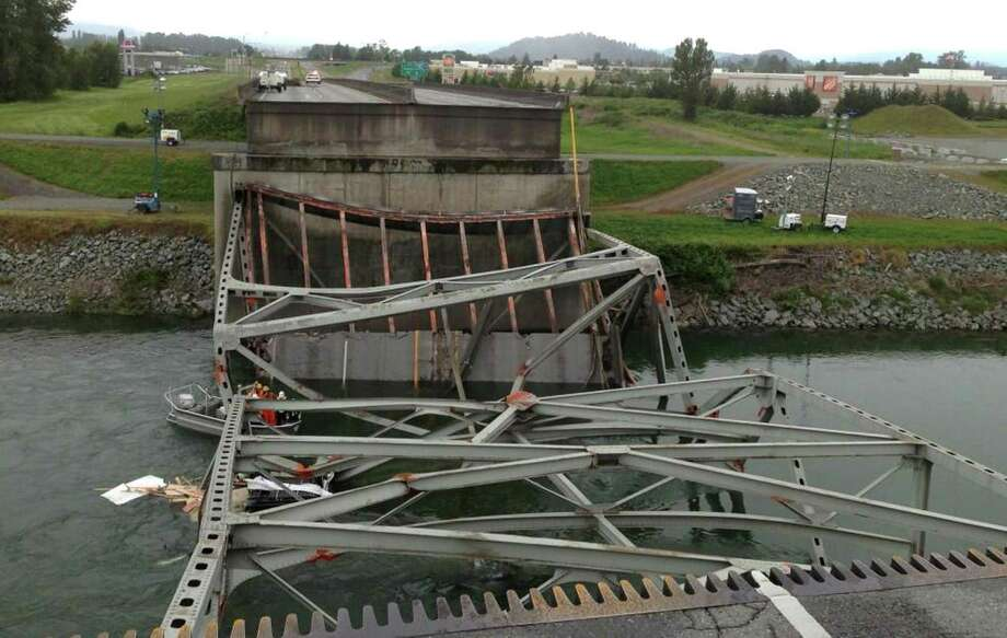 In this photo provided by the National Transportation Safety Board, the collapsed section of the Interstate 5 bridge is shown from the south end of the bridge. The view is looking north. Photo: Photo Via NTSB, NTSB / NTSB
