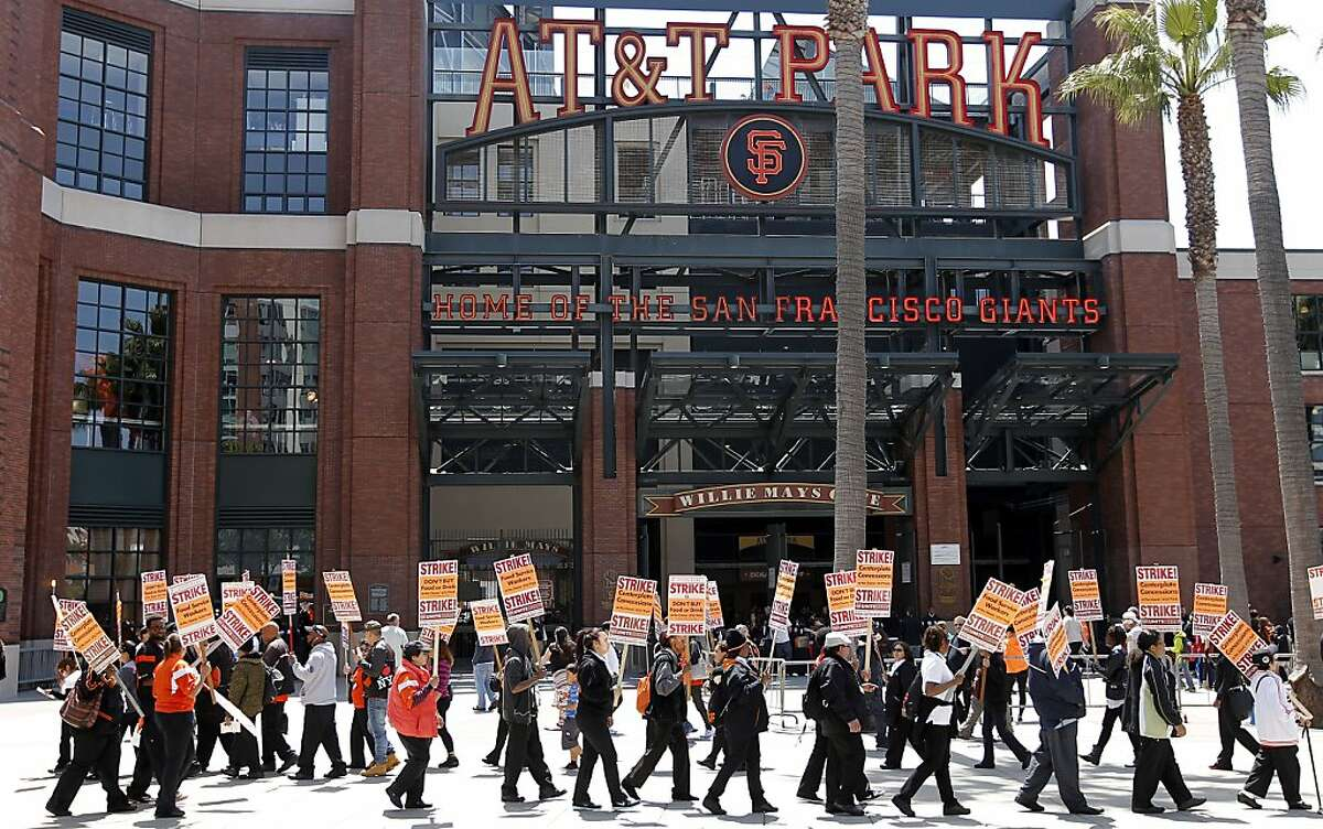 Food workers with Centerplate Concessions local 2, stage a one day strike in front of AT& T Park as the San Francisco Giants prepare inside to take on the Colorado Rockies in Major League Baseball action on Sat. May 25, 2013, in San Francisco, Calif.