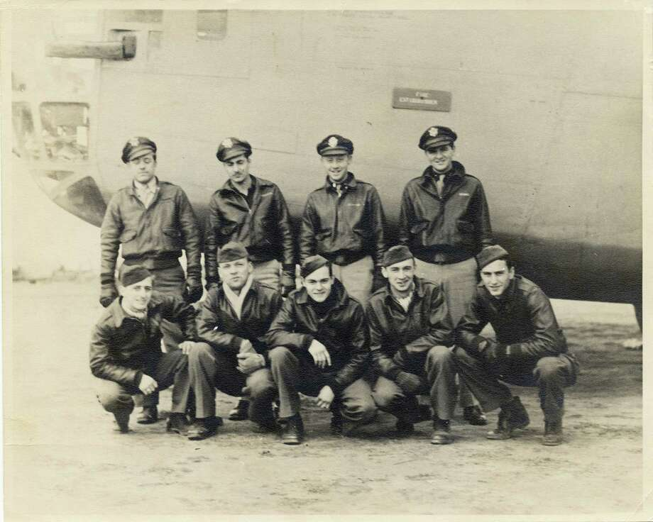 The crew of a B-24 Liberator, like the one that Boyce's father served in as left waist gunner, is shown in this undated photo. Pvt. William D. Boyce and some of these men flew in the Dec. 19, 1943, mission that is the subject of Justice Boyce's reflections. The last survivor of that mission, Sgt. Ray Noury, is pictured at bottom left. Below, Pvt. William Boyce is shown convalescing at a U.S. military hospital after he was wounded during a mission. Photo: Memorial Day