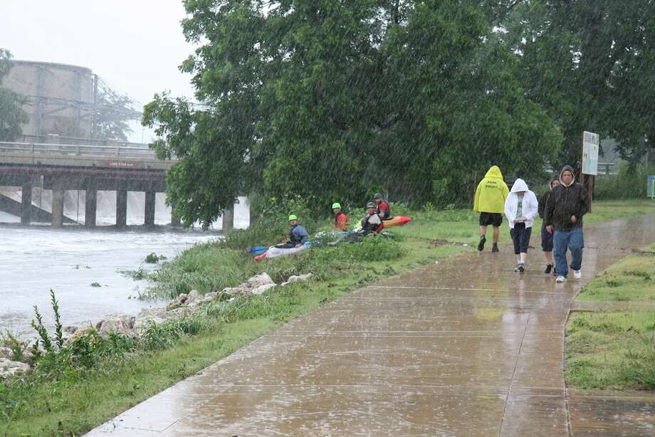 A group of kayakers being told to go away by the park police Photo: Markus Haas / Express-News