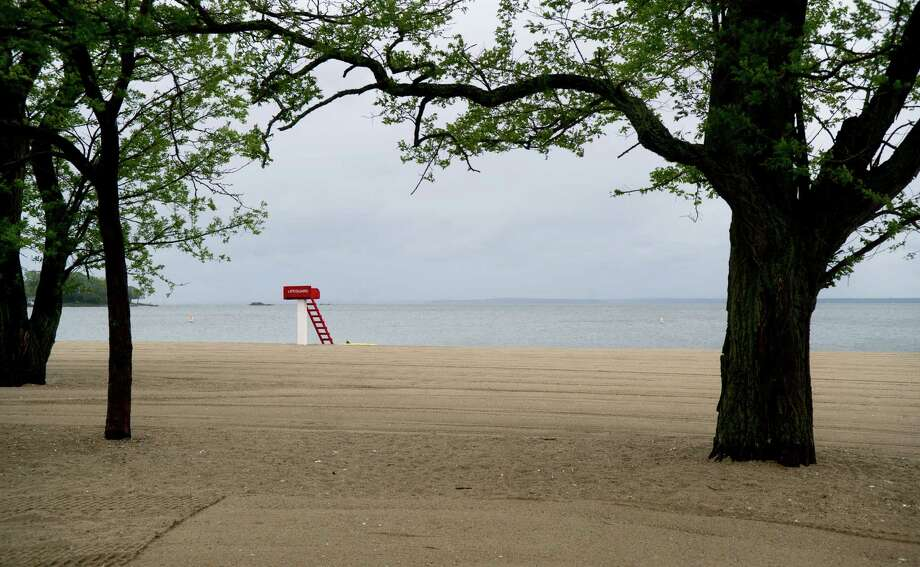 A lifeguard stand sits empty as the rain and cold keep beachgoers away on Saturday, May 25, 2013. Photo: Lindsay Perry / Stamford Advocate