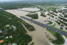 A portion of U.S. Route 281 is underwater at Basse after heavy rains in San Antonio on Saturday morning, May 25, 2013.